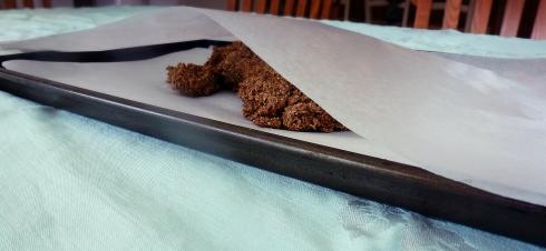 cracker mix on parchment paper