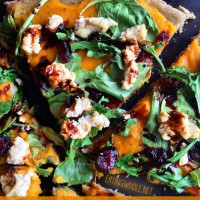 Roasted Butternut Squash Pizza: Sage flat bread with butternut squash puree, arugula, feta, cranberries, and a maple balsamic reduction